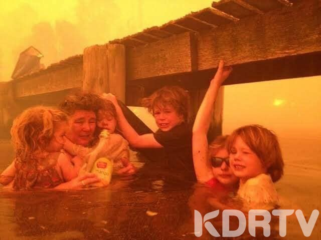 A family wait to be evacuated